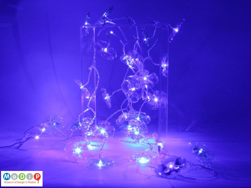 Side view of a set of lights showing full string with the lights on.
