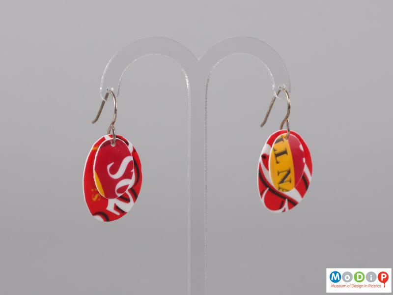 Front view of a pair of Sour Cream pot earrings showing the two layers of material hanging on the fixings.