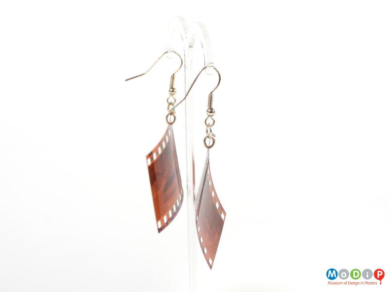 Side view of a pair of Lula dot earrings showing the negatives hanging on the metal fixings.