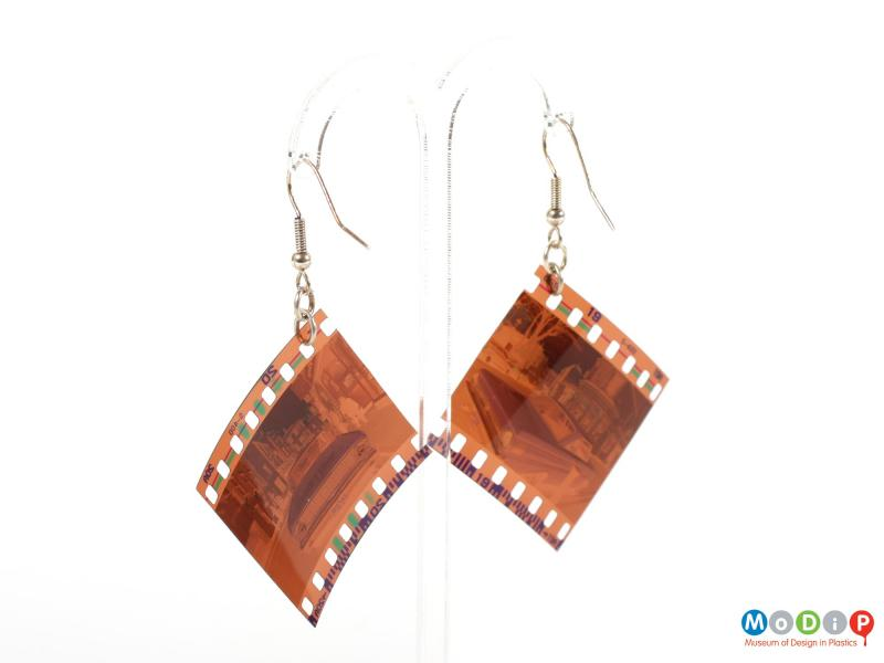 Rear view of a pair of Lula dot earrings showing the negatives hanging on the metal fixings.