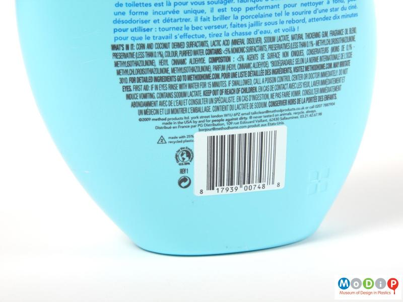 Close view of a Method bottle showing the printed text on the rear and the moulded motif.