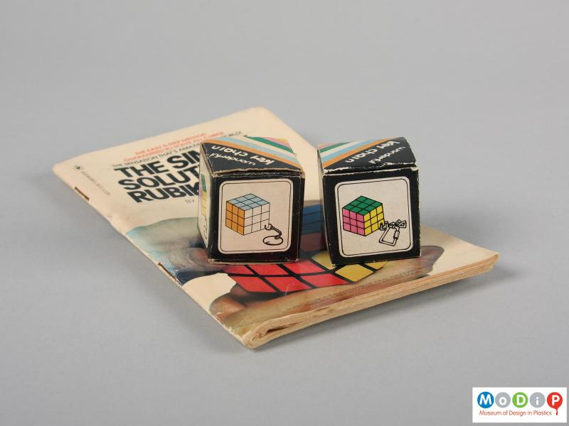 Side view of a puzzle key chain showing the boxes and the book.