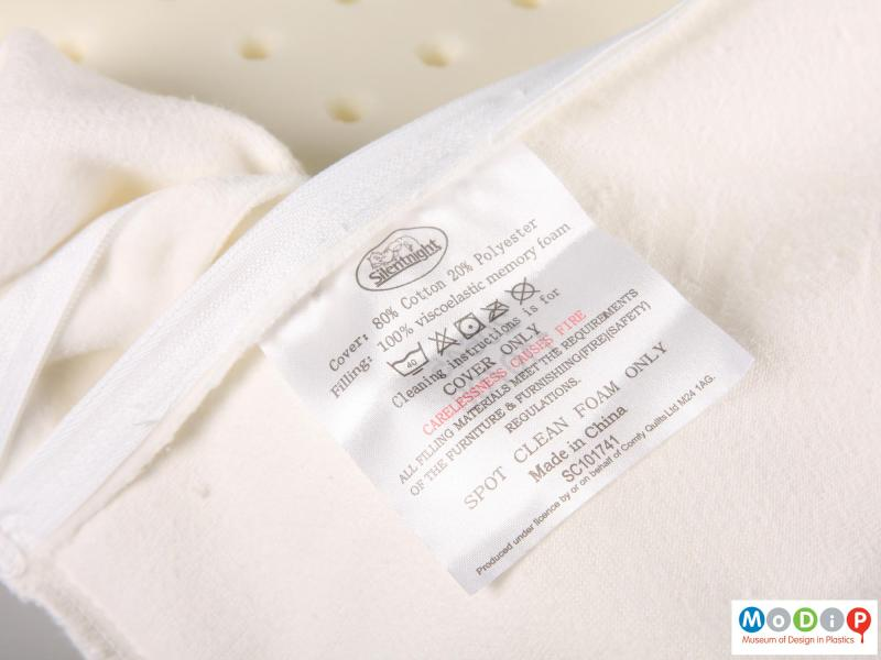 Close view of a pillow showing the label.