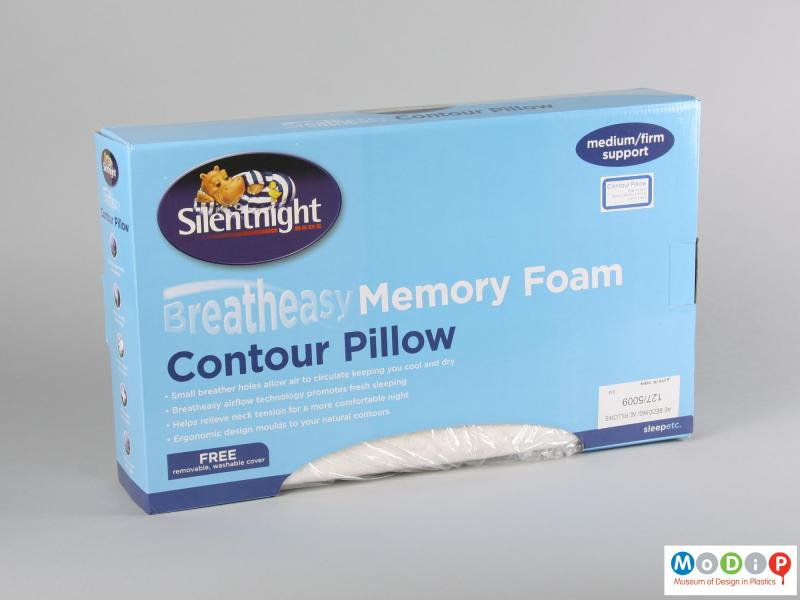 Side view of a pillow showing the packaging.