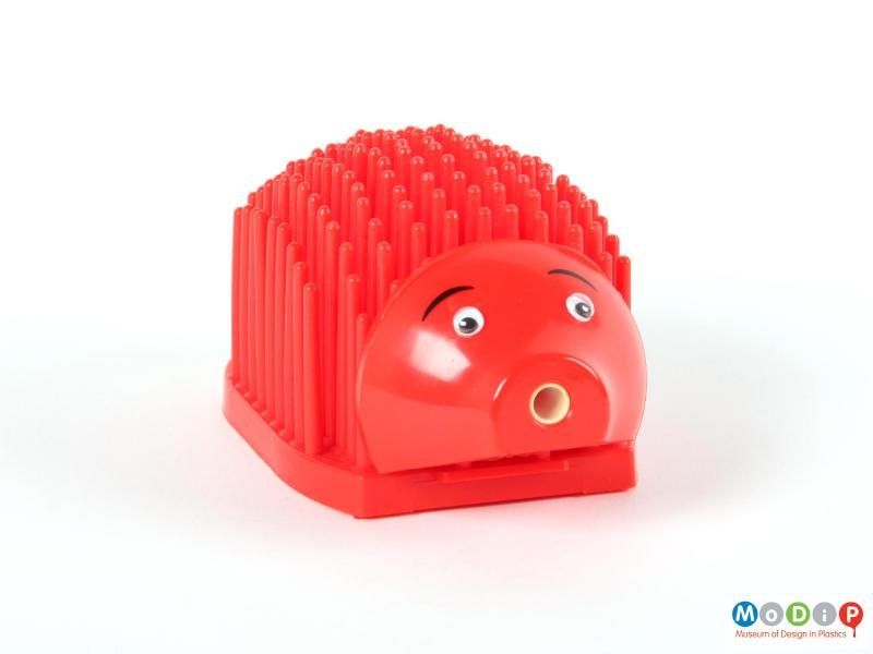 Front view of a desk tidy showing the circular mouth pencil sharpener.