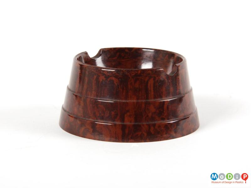 Side view of an ashtray showing the stepped and tapered side.