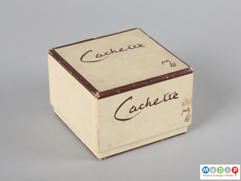 Side view of a trinket box showing the original packaging.