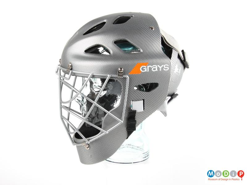 Side view of a hockey helmet showing the chin protector.