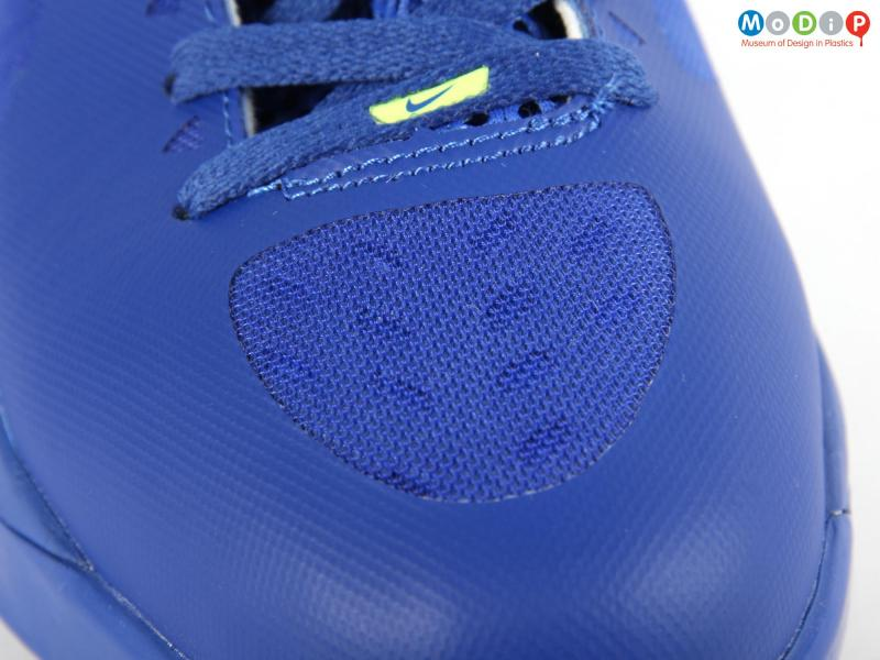 Close view of a pair of basketball boots showing the Flywire system.
