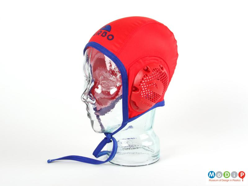 Side view of a water polo cap showing the ear protector.