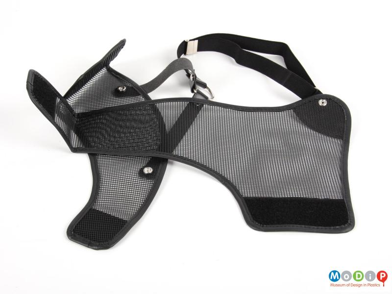 Close view of a chest guard showing the mesh panels.