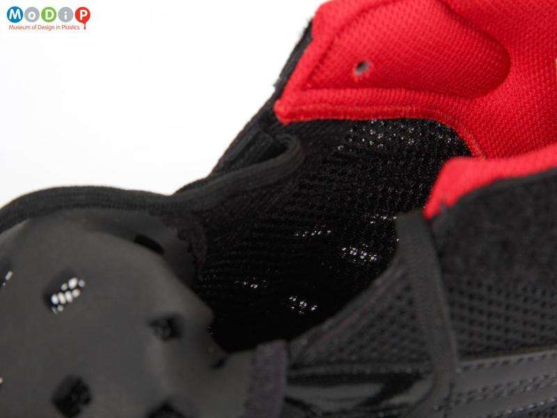 Close view of a pair of wrestling shoes showing the breathable mesh fabric.