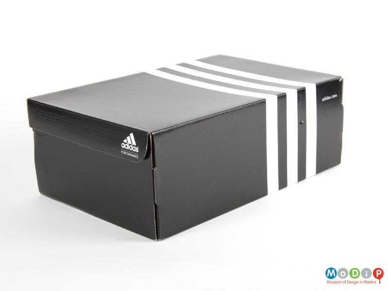 Side view of a pair of weightlifting shoes showing the packaging.