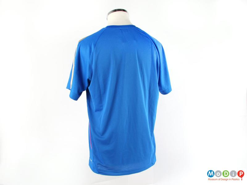 Rear view of a t-shirt showing the plain blue colouring.