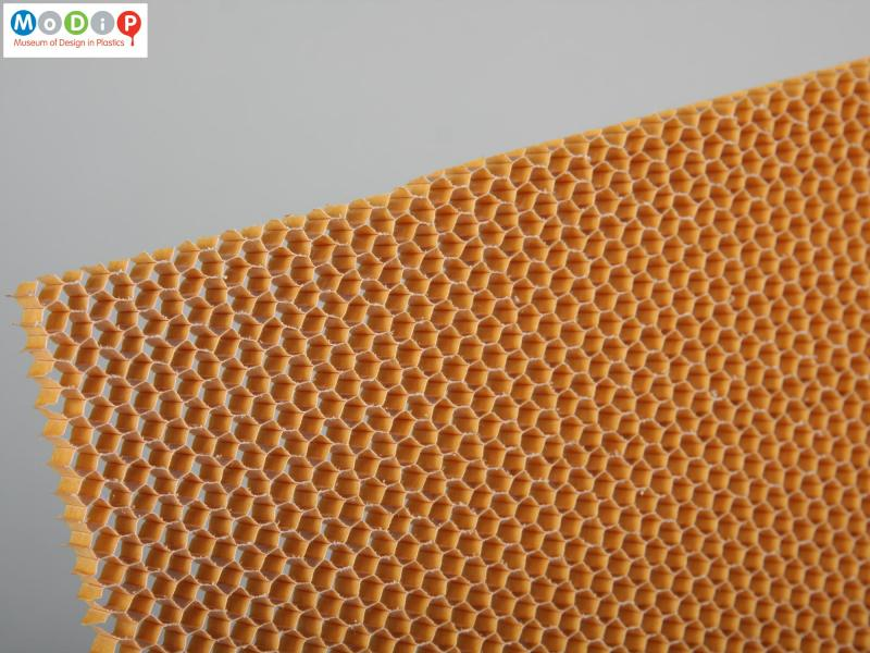 Close side view of a material sample showing the honeycomb structure.