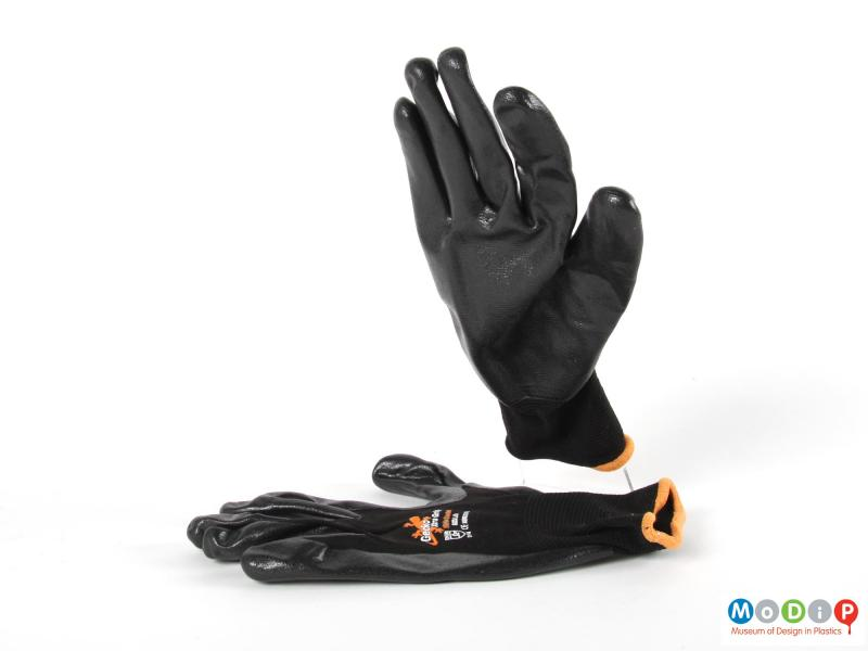 Side view of a pair of gloves showing the grippy surface.