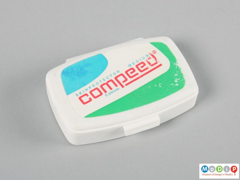 Top view of a Compeed box showing the adhesive label.