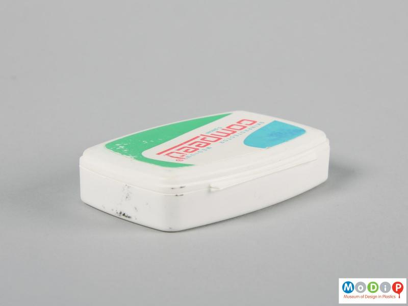 Rear view of a Compeed box showing the hinge.