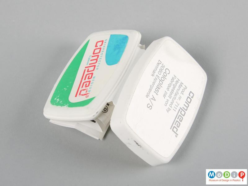 Underside view of a Compeed box showing the hinge.