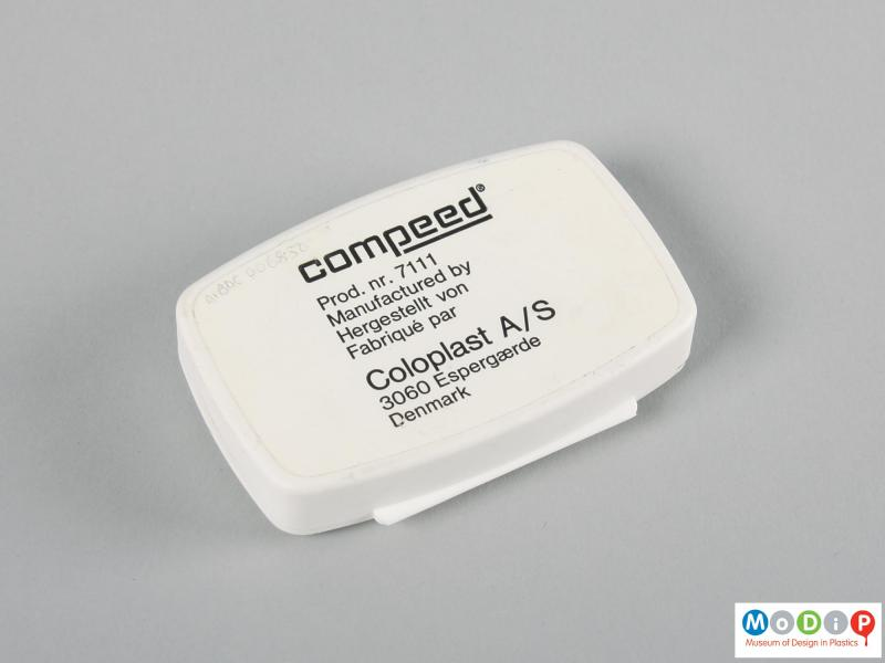 Underside view of a Compeed box showing the adhesive label.