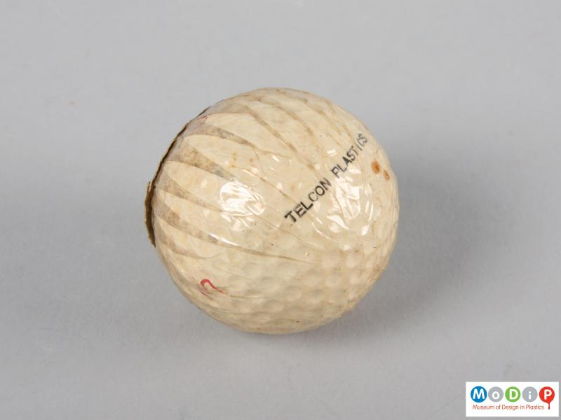 Side view of a golf ball showing the moulded dimples.