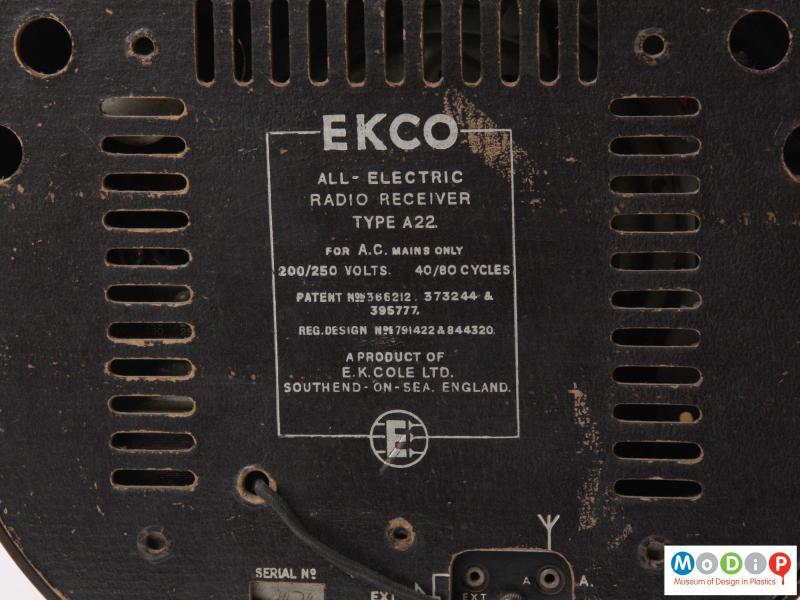 Close view of a radio showing the printed text on the back.