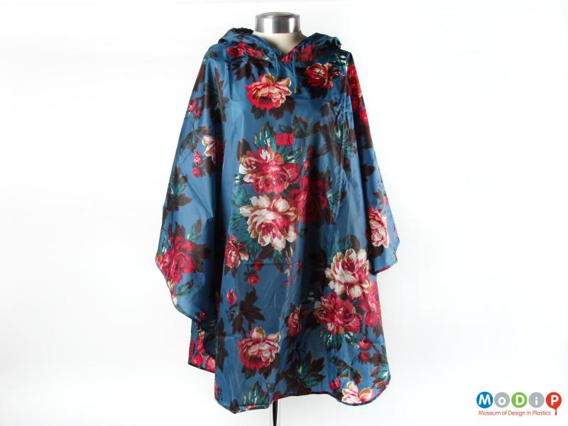 Front view of a poncho showing the large foral patterning.