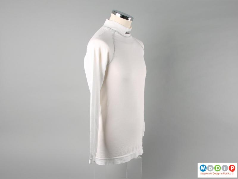 Side view of a shirt showing the raglan sleeves.