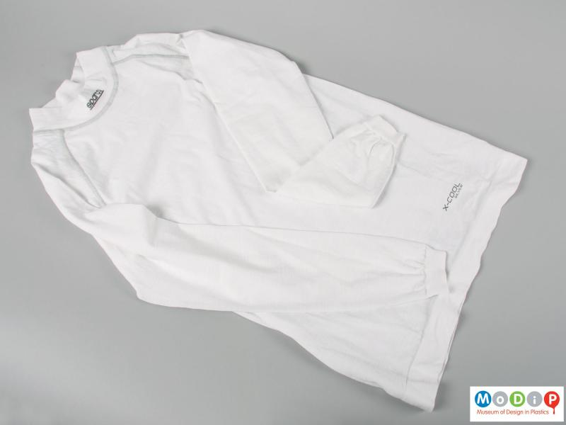 Front view of a shirt showing the high neckline.