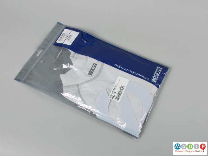 Front view of a shirt showing the packaging.