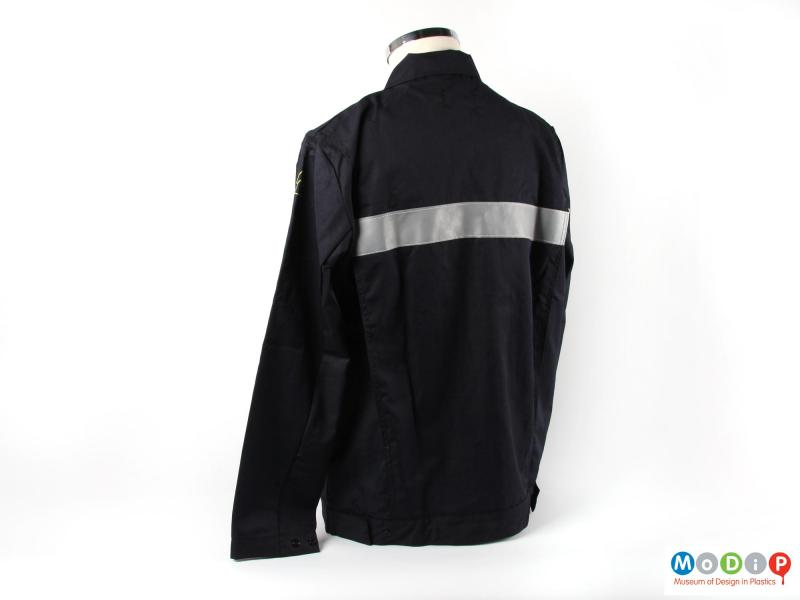 Rear view of a jacket showing the reflective back strip.