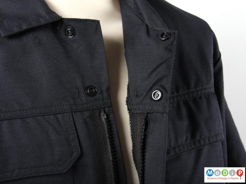 Close view of a jacket showing the fastenings.