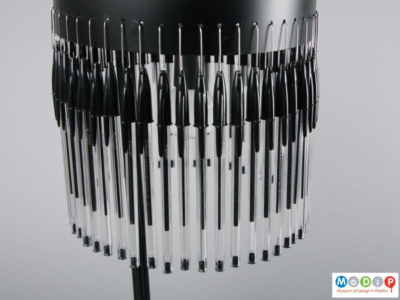 Close view of a lamp showing the pens.