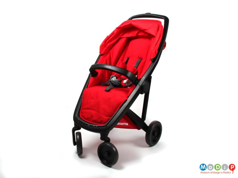 Front view of a stroller showing the rain hood down.
