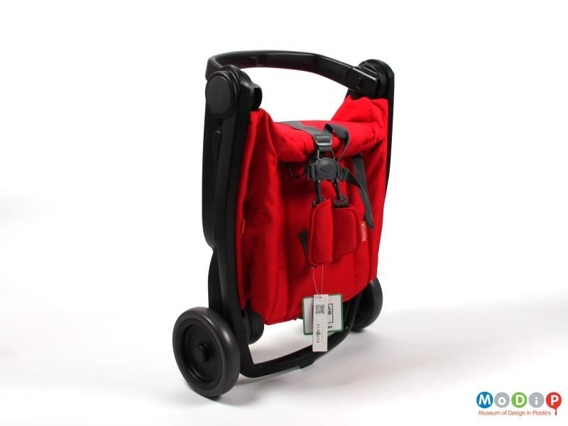 Side view of a stroller showing it folded up.