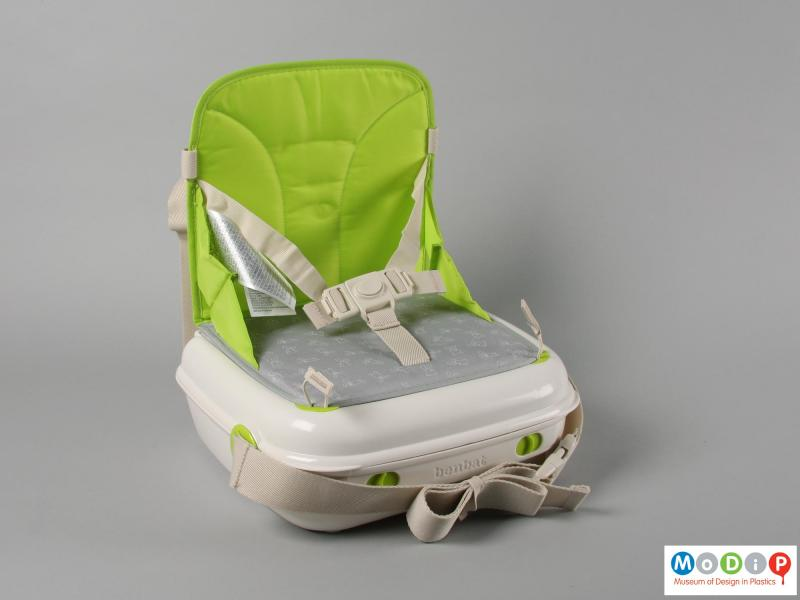 Side view of a booster seat showing the saftey straps.