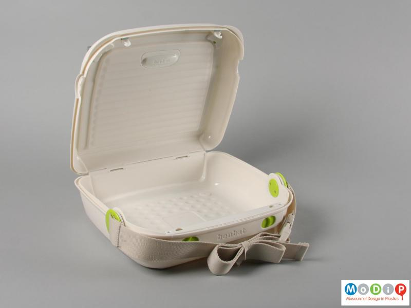 Side view of a booster seat showing the storage space.
