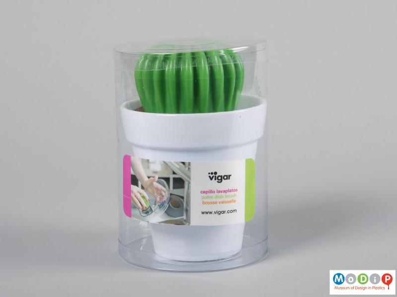 Side view of a washing up brush showing the packaging.