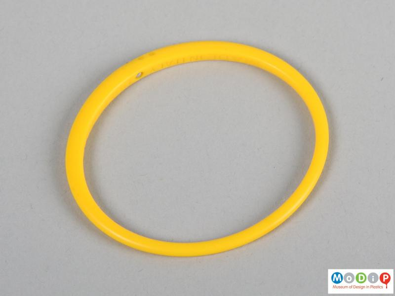 Top view of a bangle showing the differing thickness of the material.