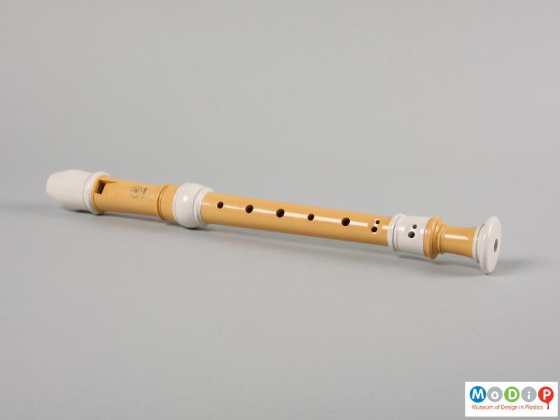 Side view of a recorder showing the finger holes.