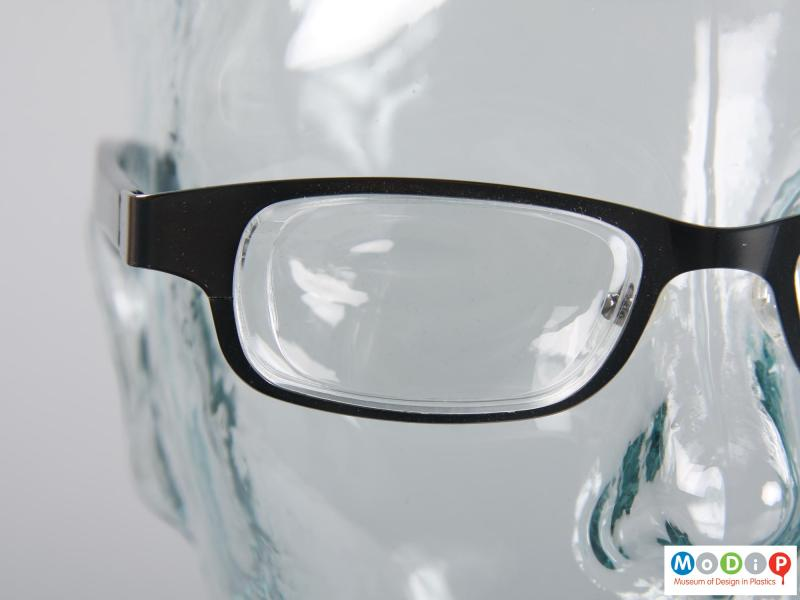 Close view of a pair of glasses showing the lenses.