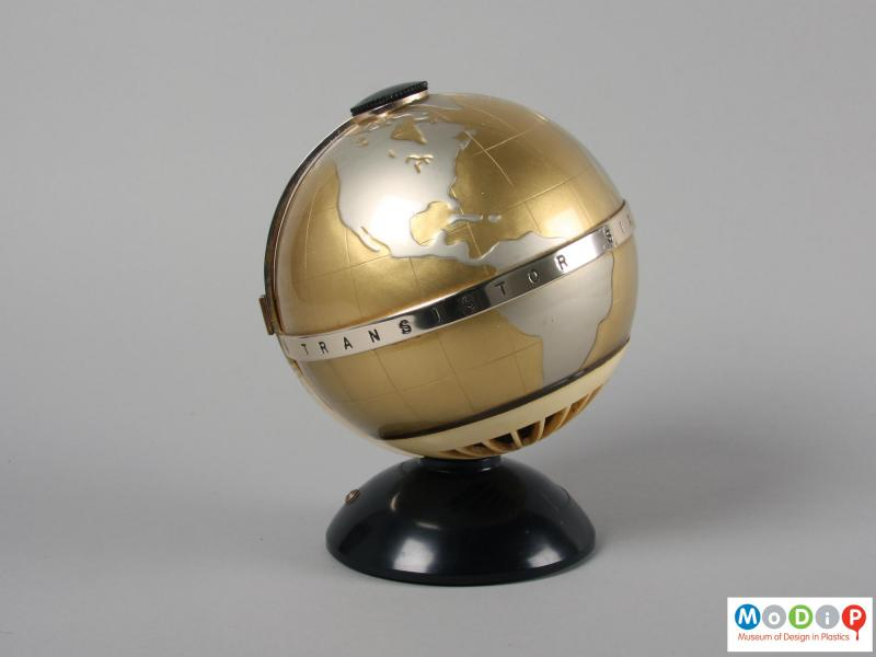 Side view of a radio showing the globe shape.