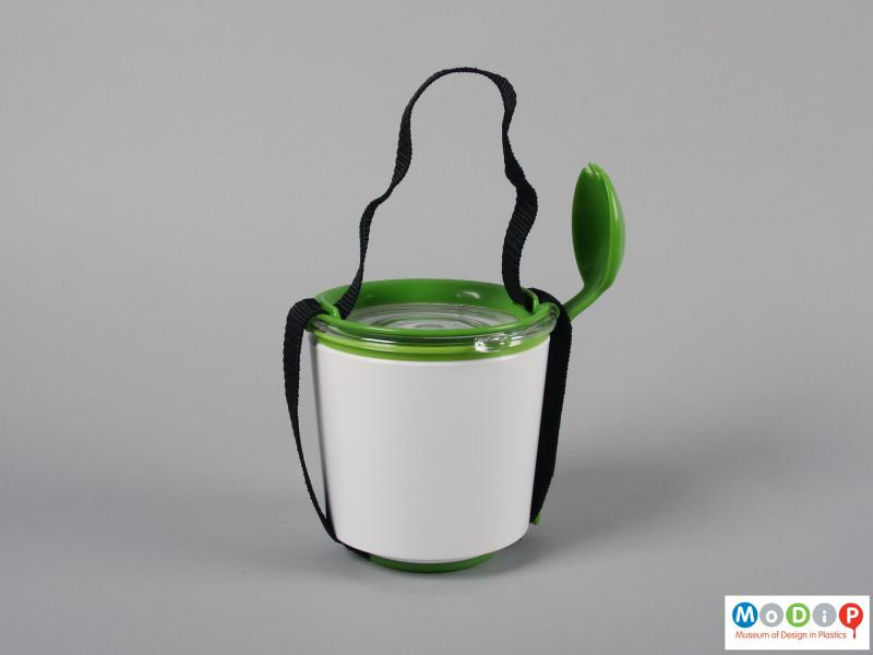 Side view of a lunch pot showing the carrying handle on the compressed set up.
