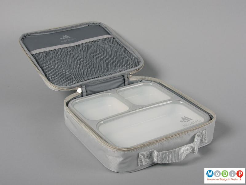 Side view of a lunch box showing the carrying bag.