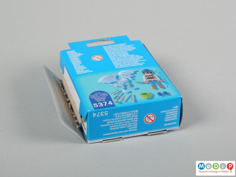 Rear view of a figure showing the packaging.