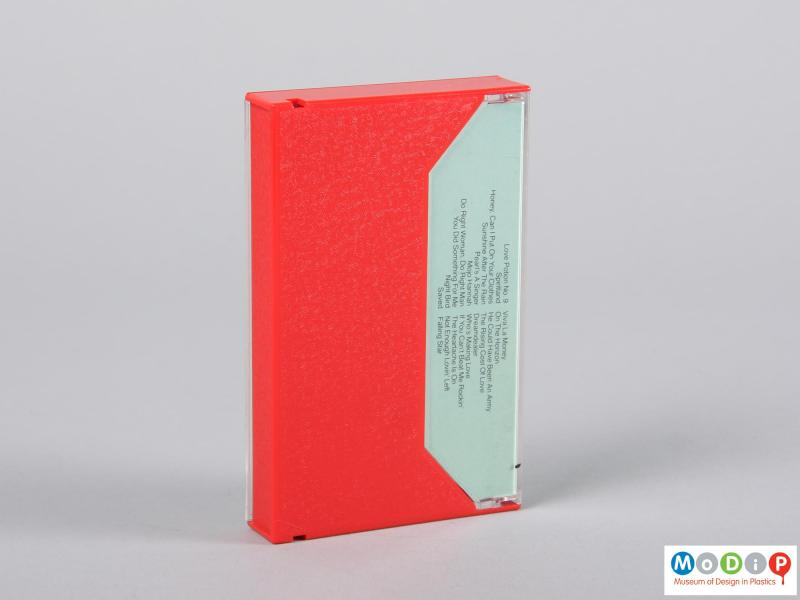 Rear view of a cassette tape showing the red opaque back cover.