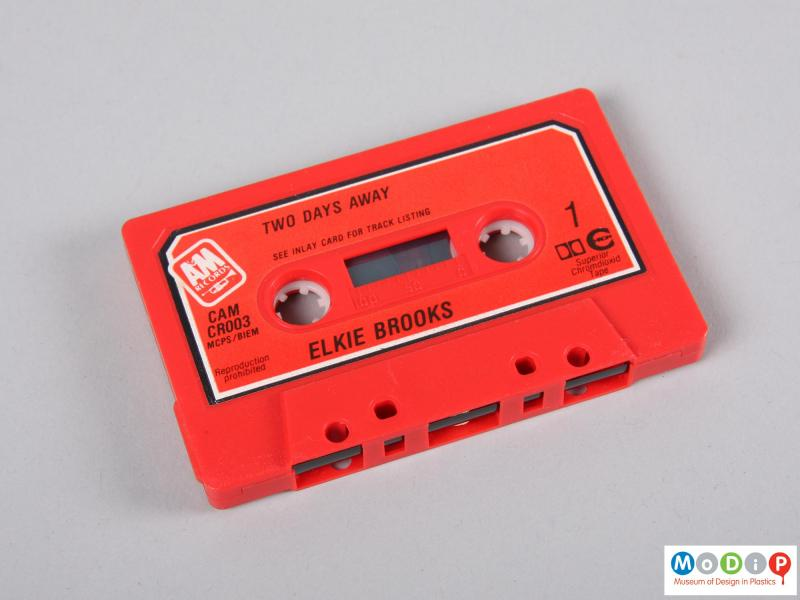 Side view of a cassette tape showing side one.