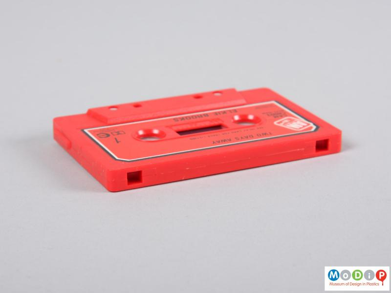 Side view of a cassette tape showing moulded shape.