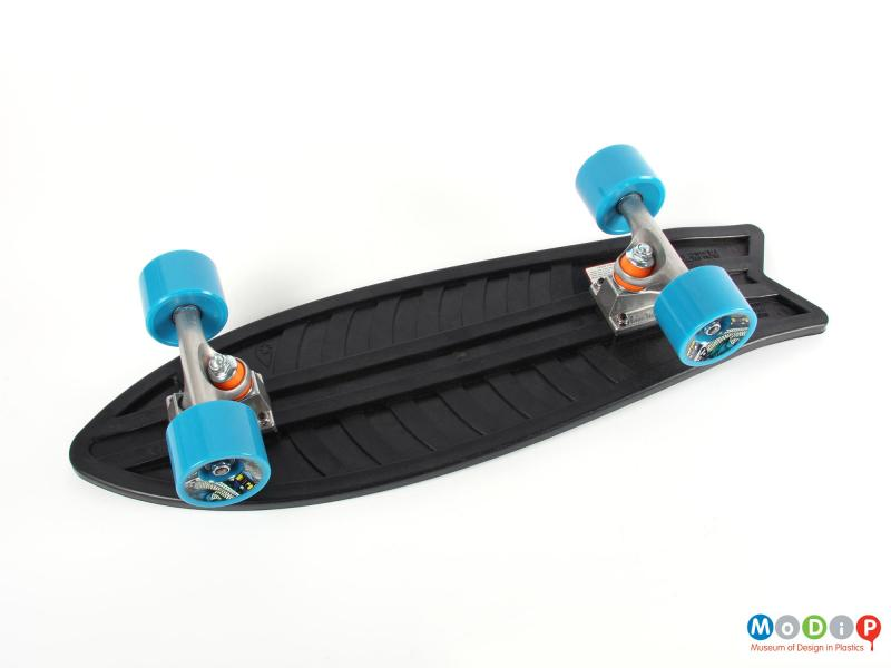 Underside view of a skateboard showing the wheel mounts.
