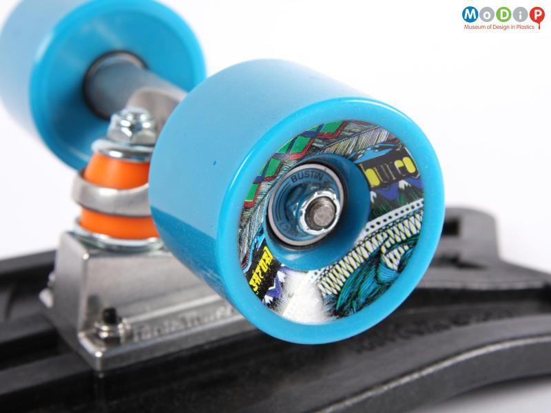 Close view of a skateboard showing the wheel.
